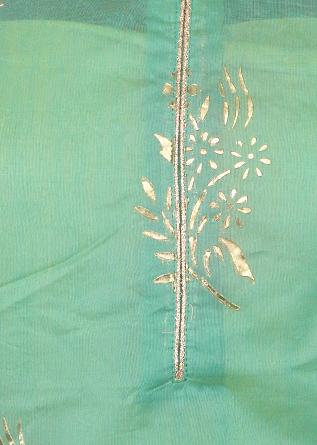 Sea blue semi stitched suit in embossed foil printed butti