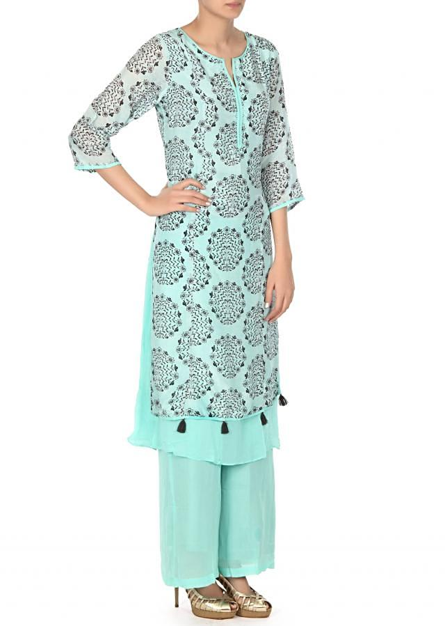 Sea blue straight suit adorn in floral printed butti only on Kalki