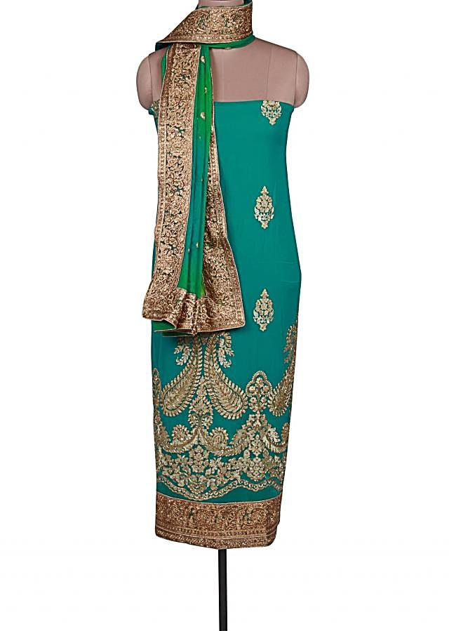 Sea blue unstitched suit adorn in resham and kardana embroidery only on Kalki