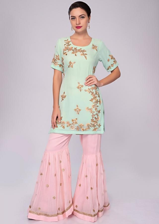 Sea green embroidered suit with pink sharara and net dupatta only on Kalki