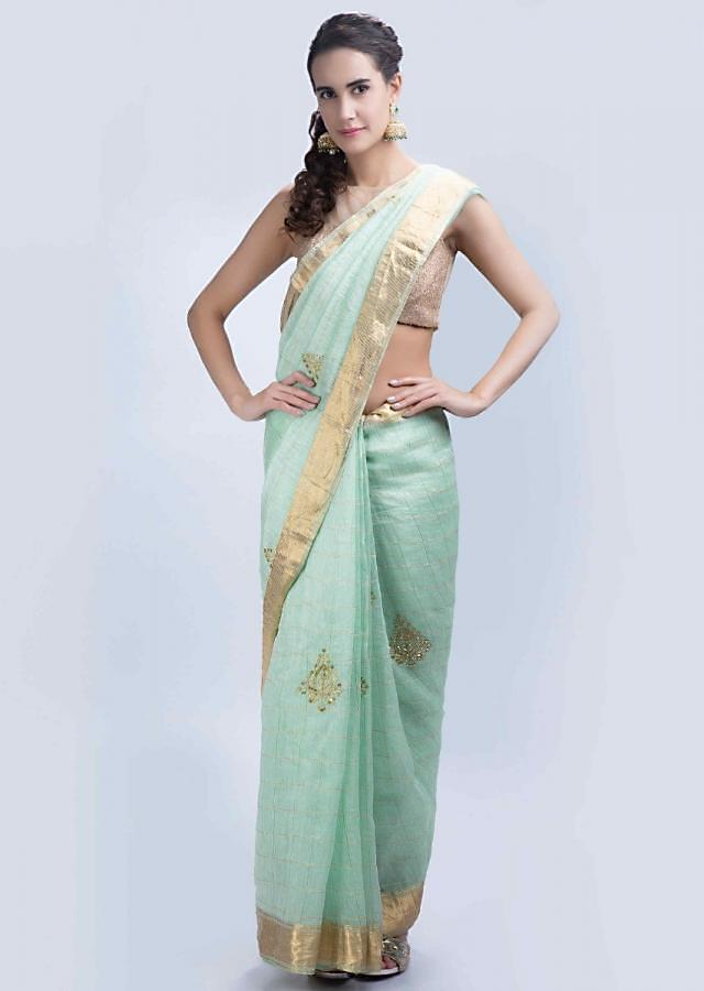 Sea green linen saree with checks and embroidered butti only on Kalki