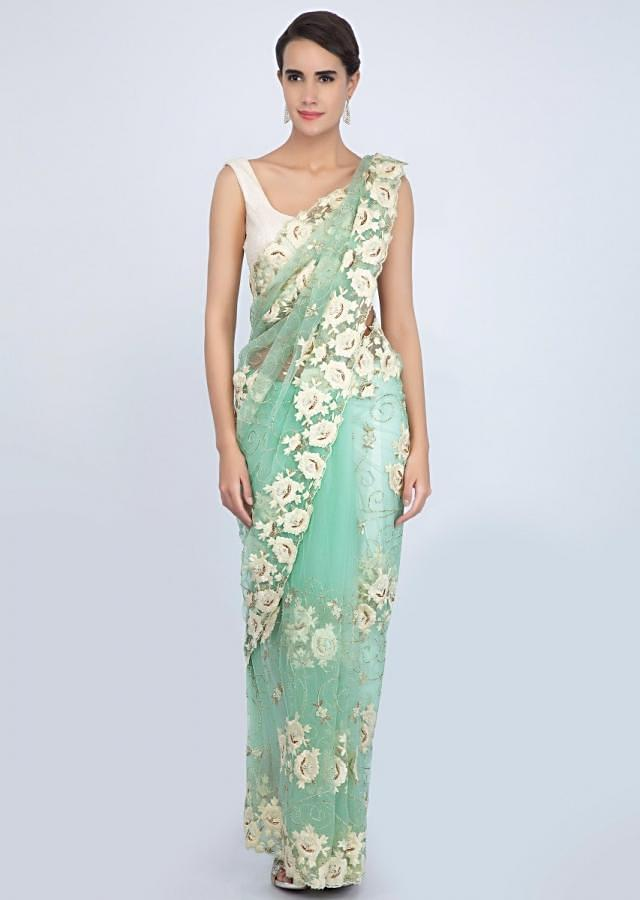 Sea green net saree with jaal embroidery on the lower bottom and pallo. only on Kalki