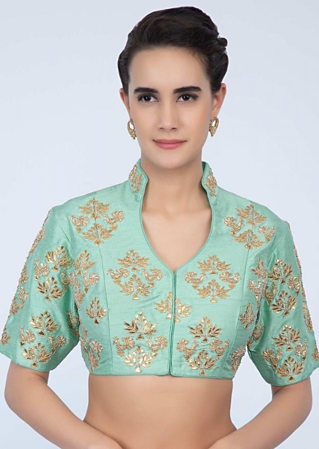 Sea green raw silk blouse with embroidered butti in floral and bird motif only on Kalki