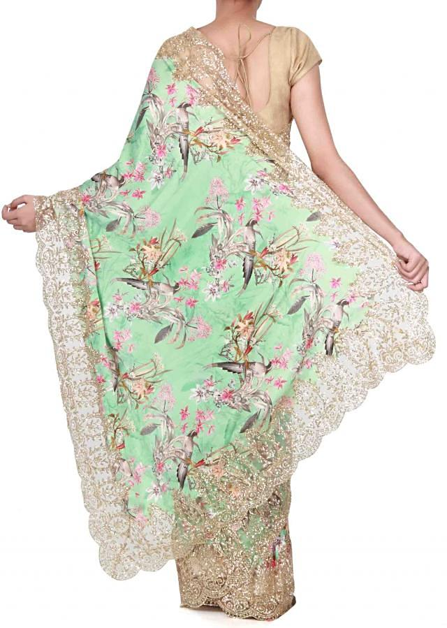 Sea green saree adorn in floral print only on Kalki