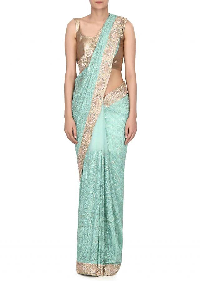 Crystal sea green saree adorn in thread and kundan embroidery only on Kalki