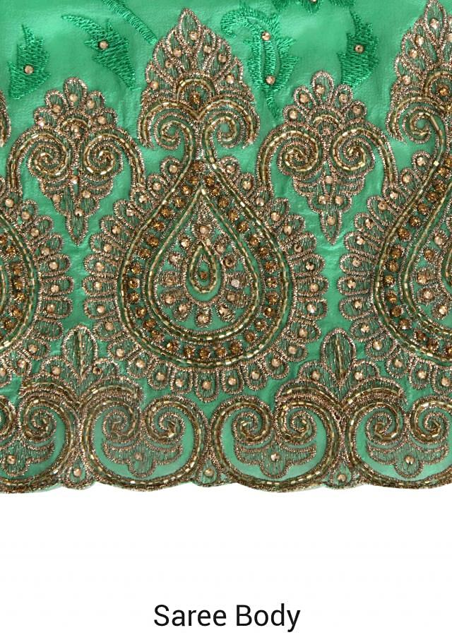 Spectra green saree embellished in thread and zari only on Kalki