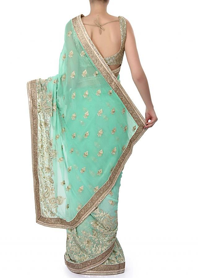 Sea green saree enhanced in resham embroidery only on Kalki