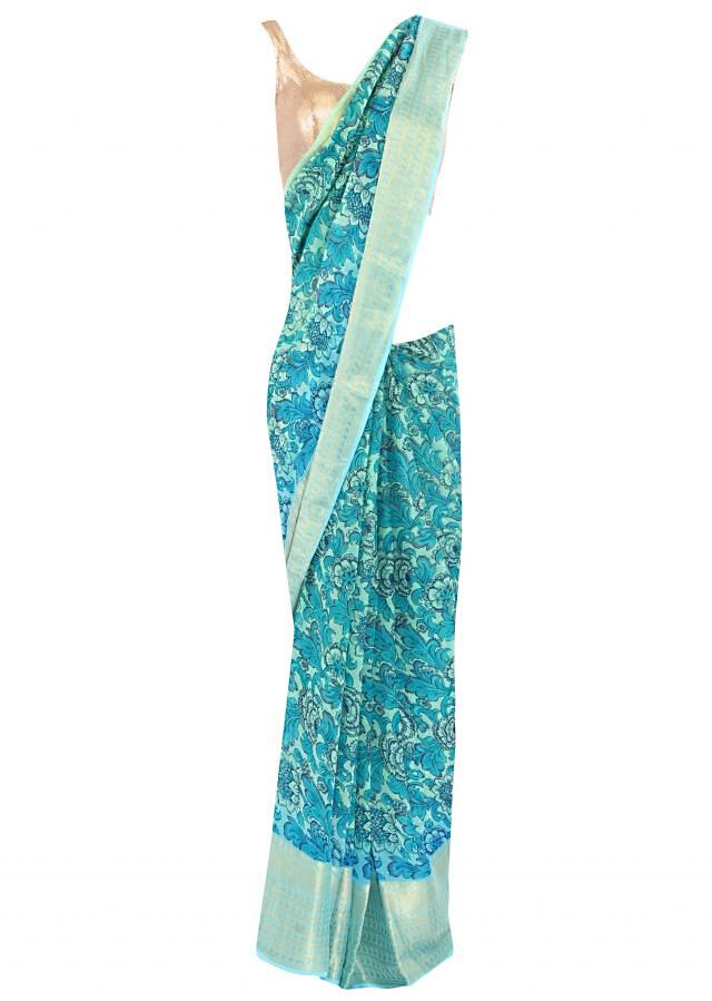 Sea green saree in floral print and weaved border only on Kalki