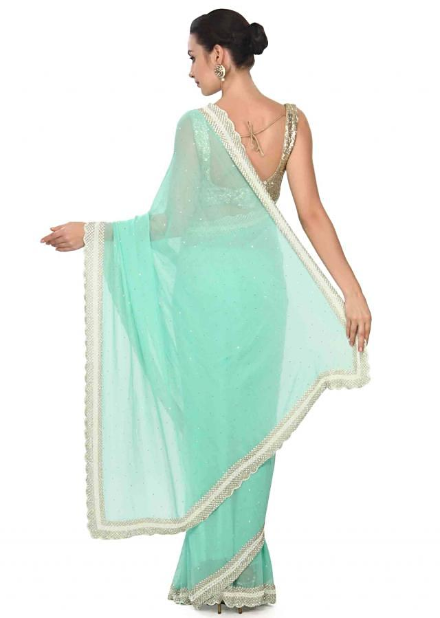 Bay green saree with stone and pearl border only on Kalki
