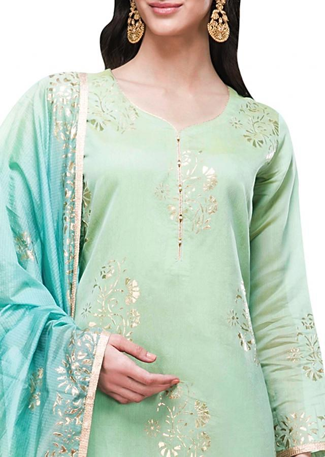 Sea green semi stitched suit in embossed foil printed butti