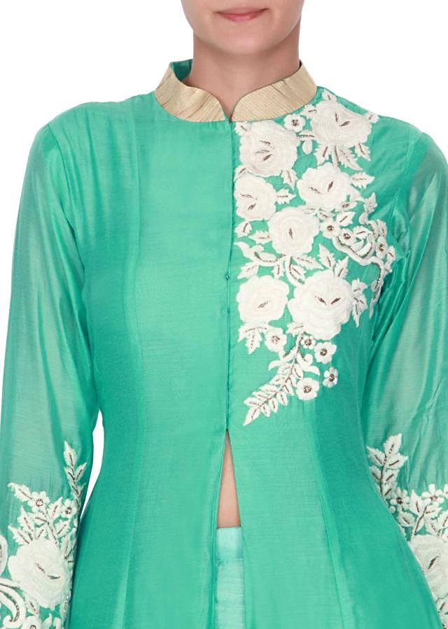 Sea green suit adorn in thread and pearl embroidery only on Kalki
