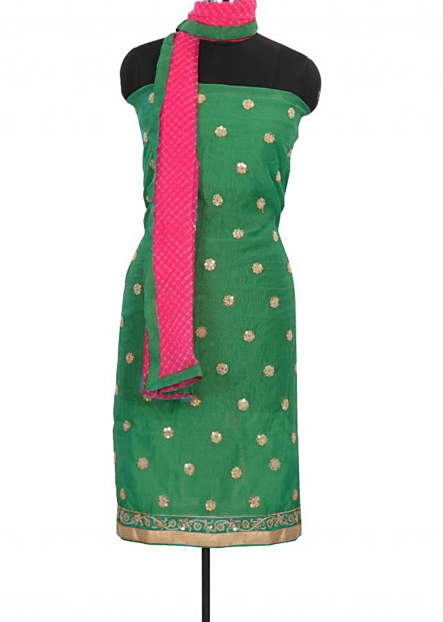 Sea green unstitched suit adorn in zari butti only on Kalki