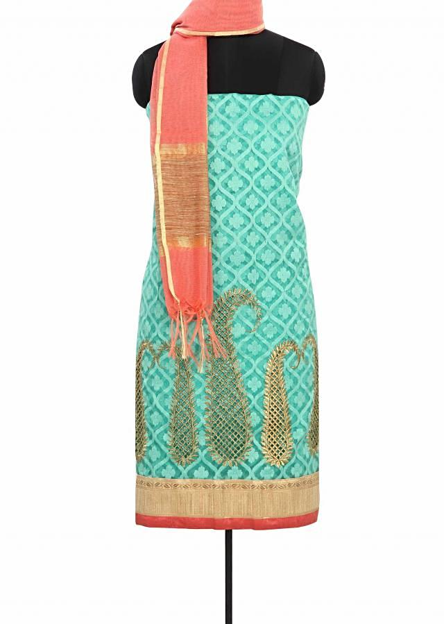 Sea green unstitched suit enhanced in paisley motif work only on Kalki