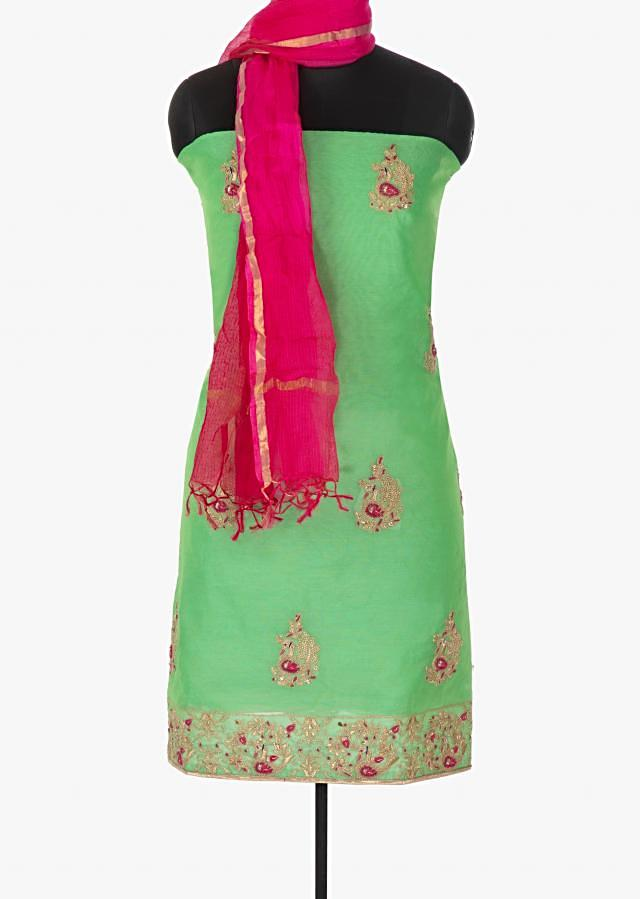 Sea green unstitched suit in bird motif embroidery only on Kalki