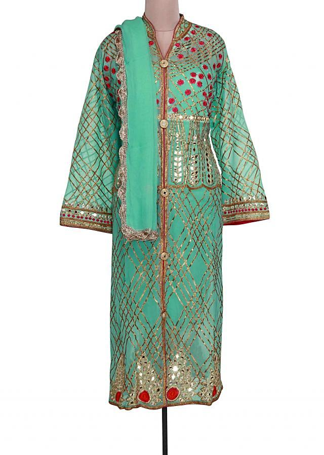Sea blue semi stitched suit adorn in resham and gotta lace only on Kalki