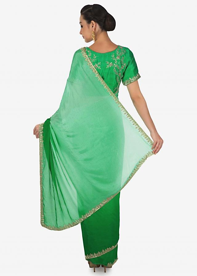 Sea green and turq green shaded saree adorn in cut dana embroidery only on Kalki