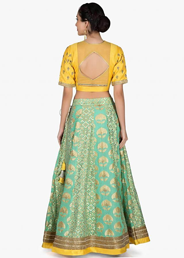 Sea green lehenga in brocade silk with yellow embroidered blouse only on Kalki
