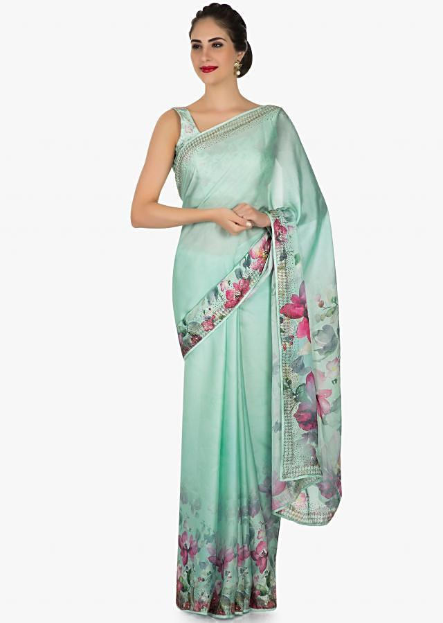Sea green saree in satin with floral print adorn in kundan work only on Kalki