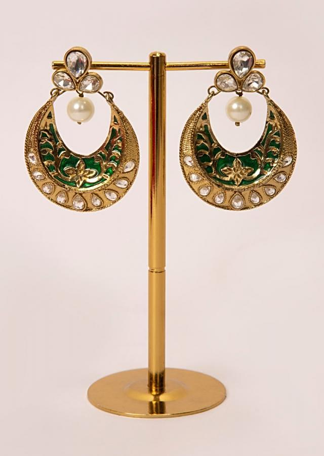 Self carved chandbali earring enhanced with kundan and  pearl