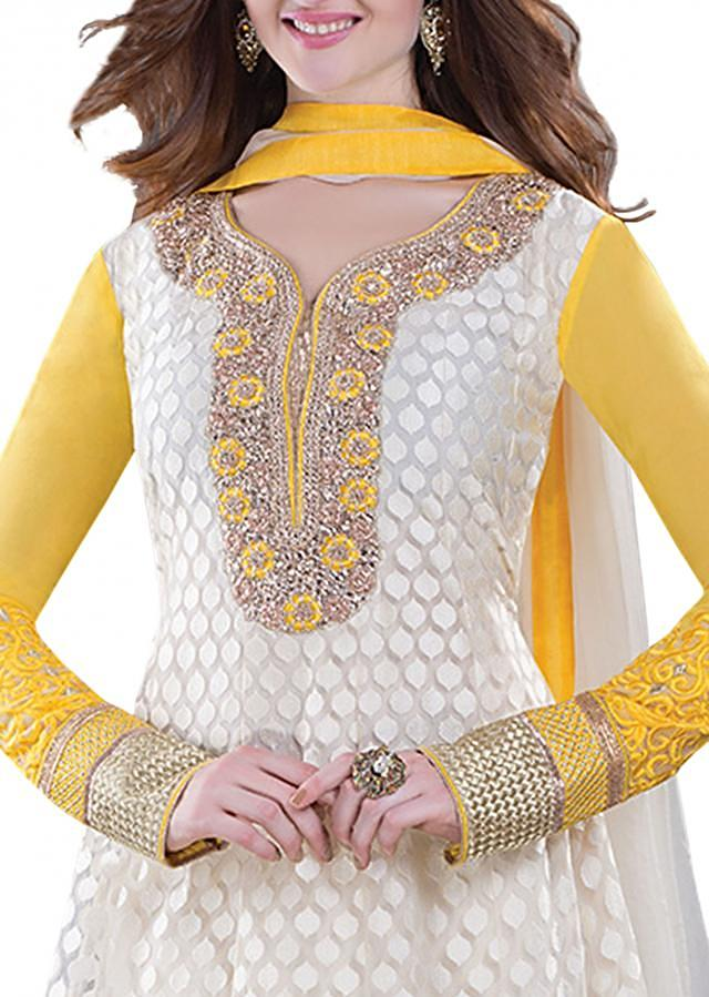 Semi stitched off white straight cut featuring kundan and stone embroidery
