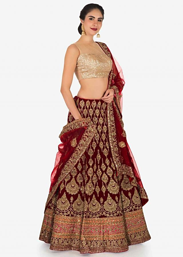 Semi stitched lehenga in maroon velvet with embroidered butti only on Kalki