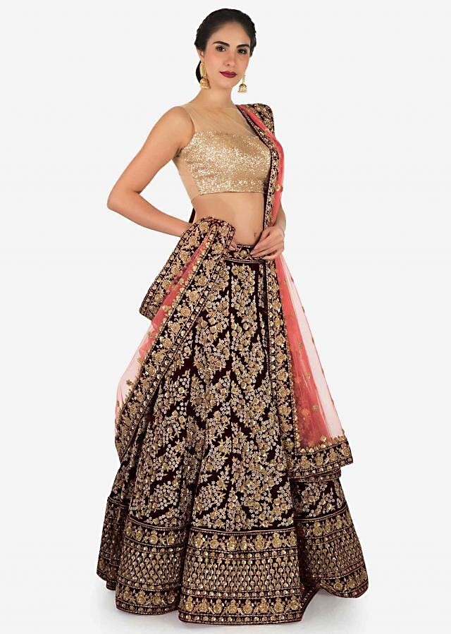 Semi stitched lehenga in maroon with coral pink dupatta in net only on Kalki