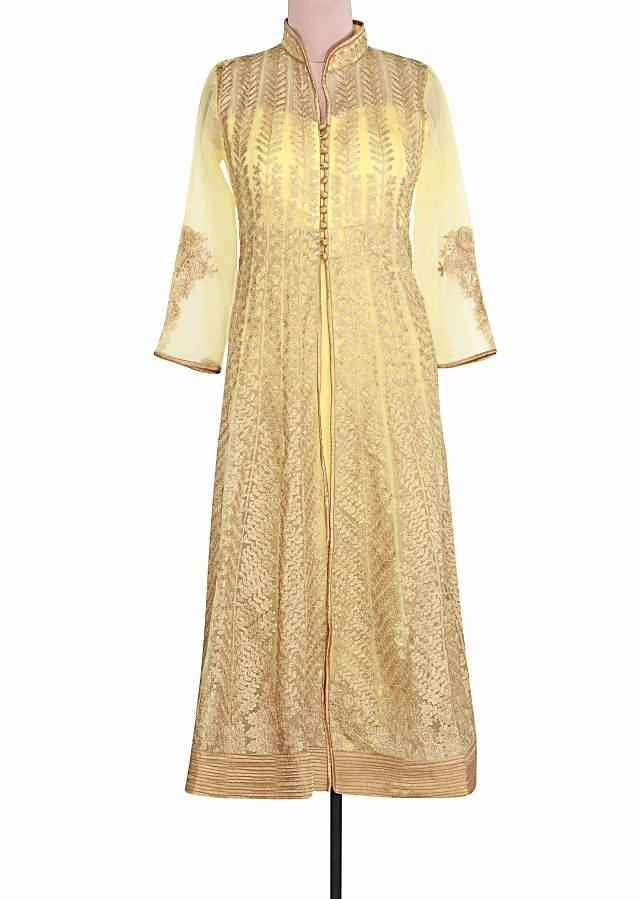 Semi stitched suit in lime yellow embellished in zari embroidery only on Kalki
