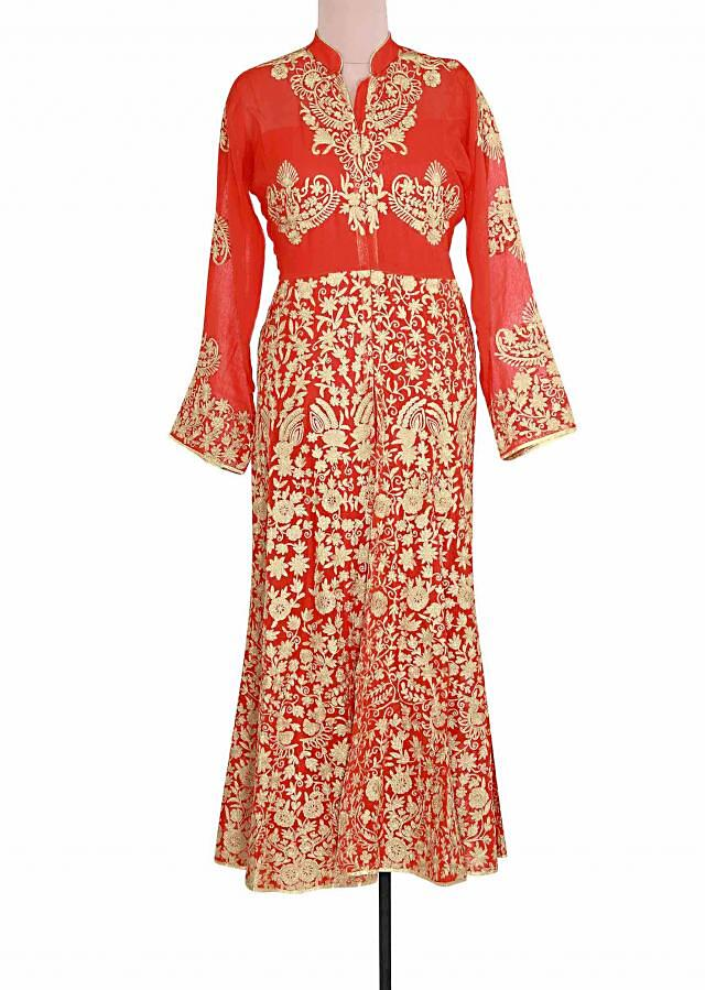 Semi stitched suit in orange embellished in zari embroidery only on Kalki