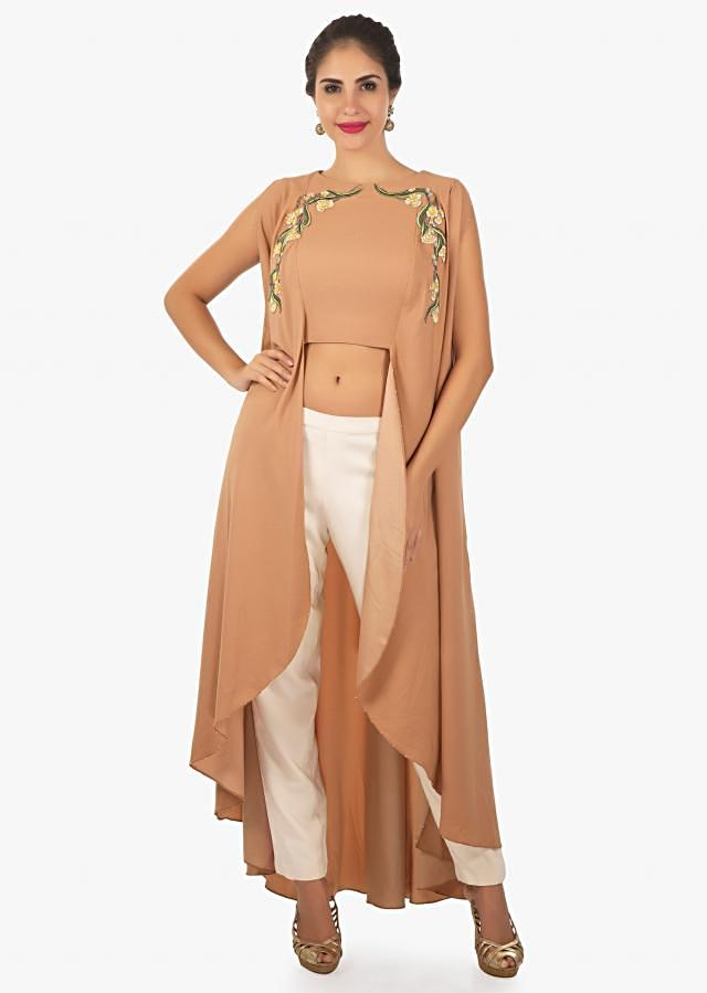 Sepia peach long tunic paired with a straight crepe pant only on Kalki