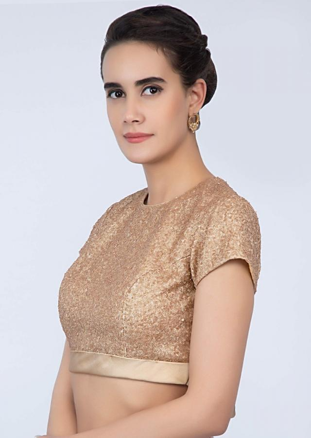 Sequins fabric honey gold blouse with tie up closure at the back only on Kalki