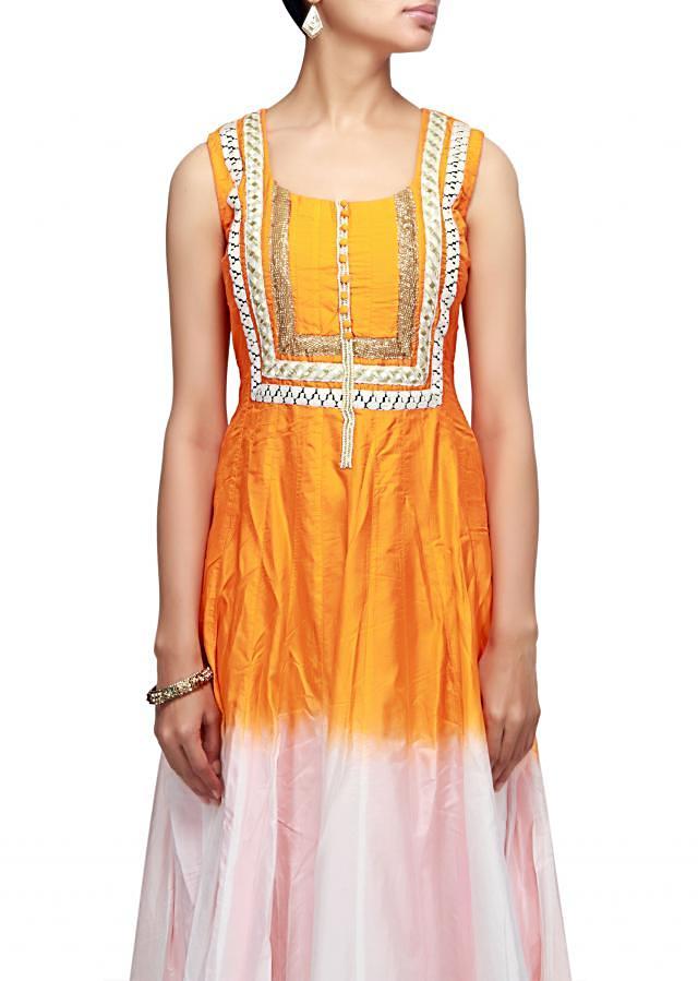 Shaded anarkali suit in white and orange with embroidered neckline