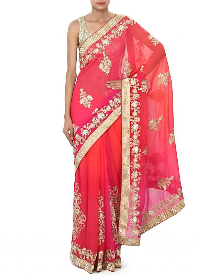 Shaded saree in coral and pink enhanced in gotta patti embroidery only on Kalki