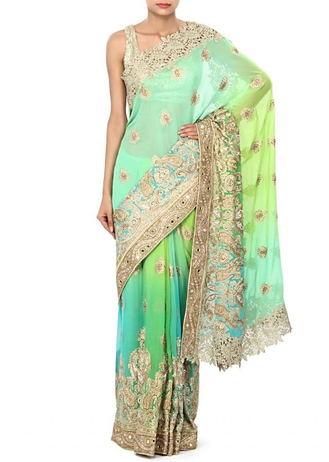 Saree in green and turq enhanced in zari and kundan embroidery only on Kalki