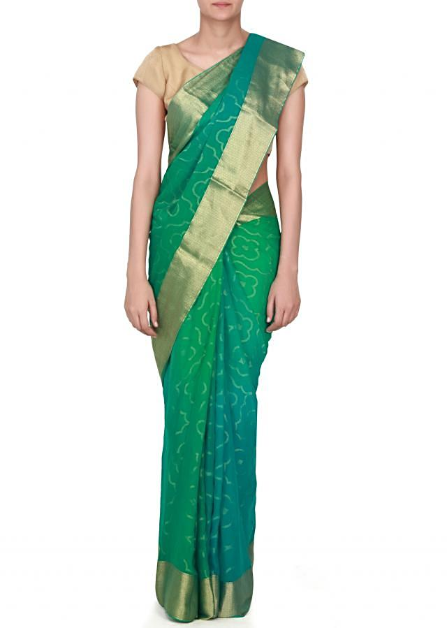 Jasper green shaded saree in chiffon with weave embroidery only on Kalki