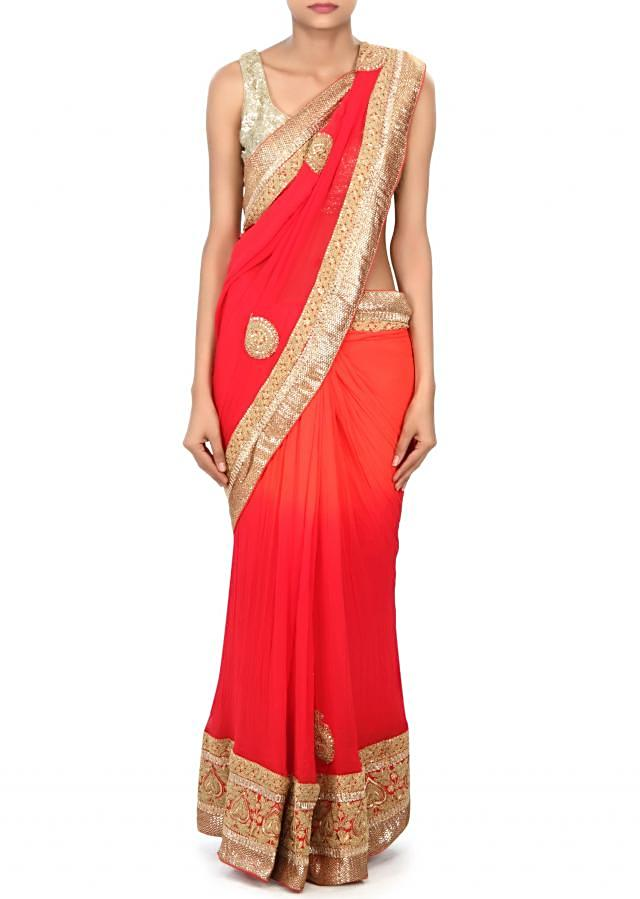Shaded saree in orange and red enhanced in kundan and zari border only on Kalki
