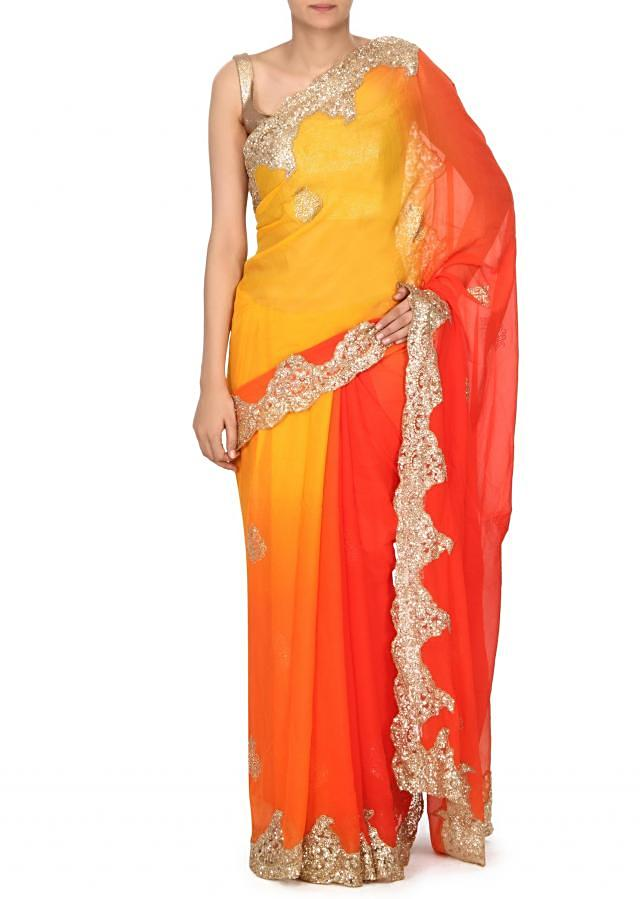 Shaded saree in orange and yellow with sequin border only on Kalki