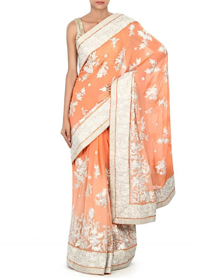 Shaded saree in peach adorn in kundan and zari embroidery only on Kalki