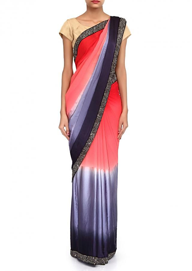 Shaded saree in peach and navy blue enhanced in border only on Kalki