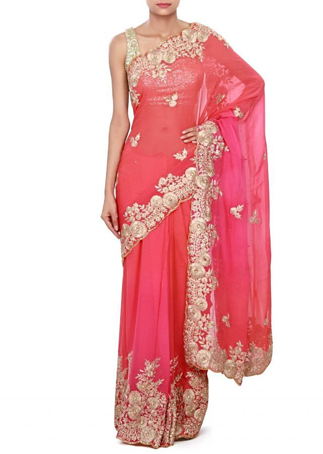 Shaded saree in peach and pink enhanced in zari and kundan embroidery only on Kalki