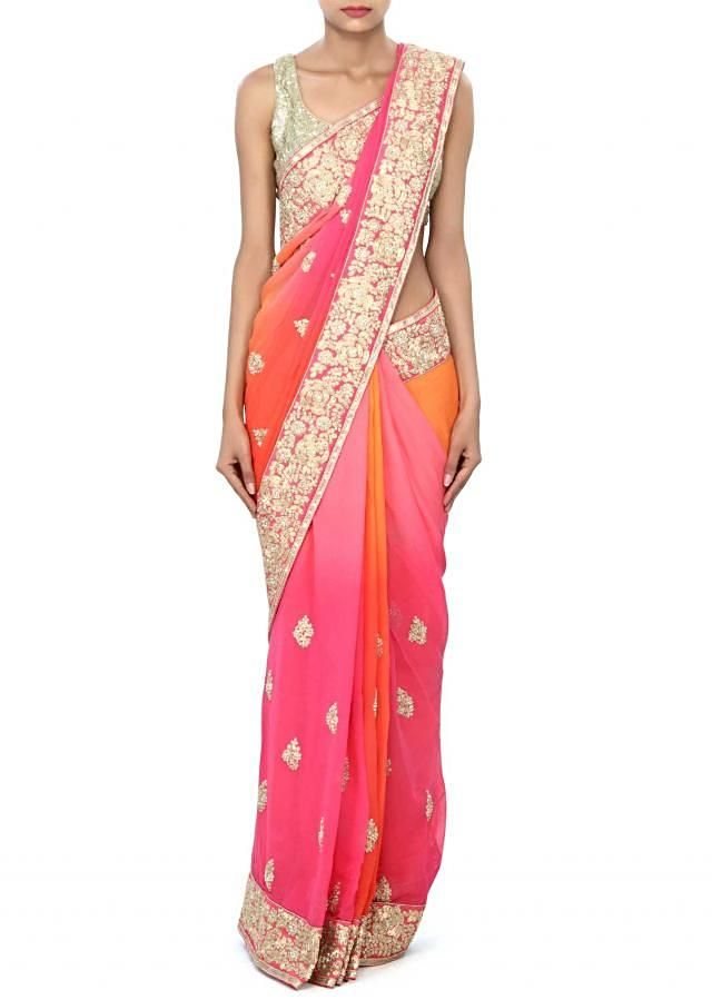 Shaded saree in pink and orange enhanced in pearl and zari embroidery only on Kalki