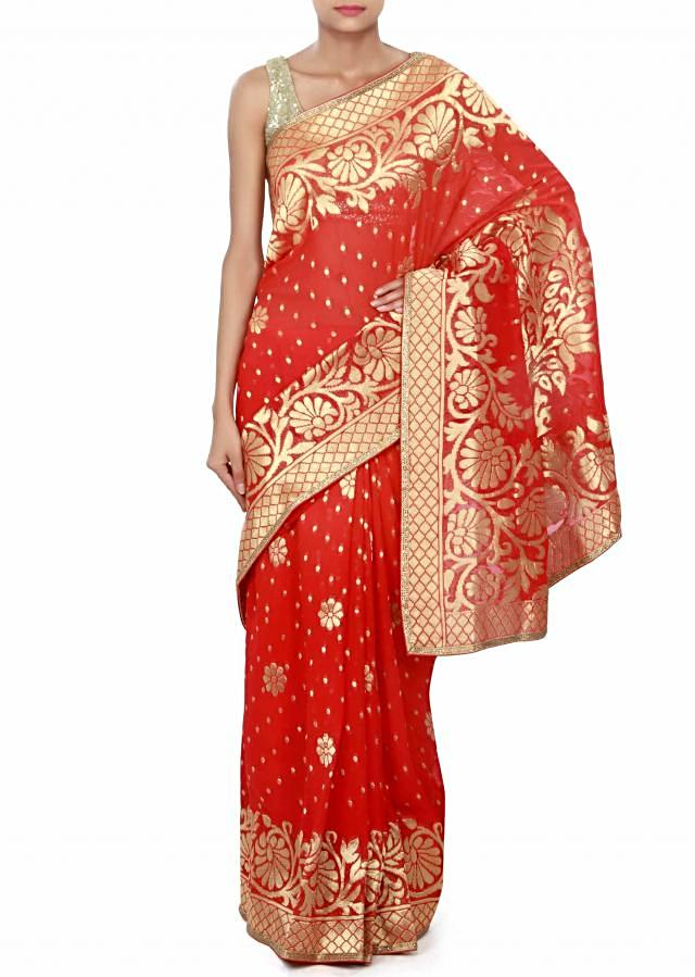 Shaded saree in red and orange adorn in weave embroidery only on Kalki