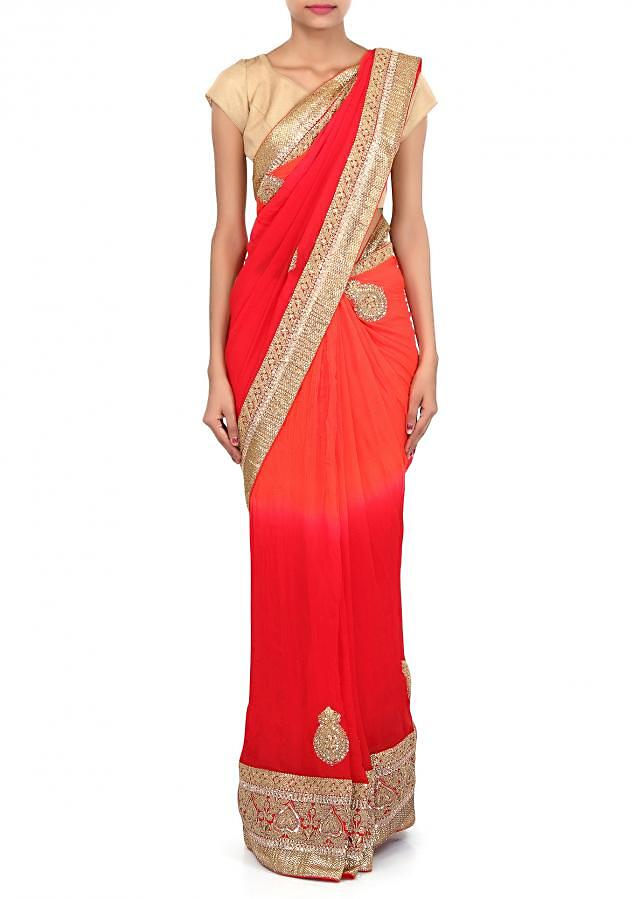 Shaded saree in red and orange adorn in zari and sequin embroidery only on Kalki