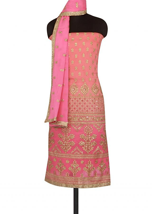 Shaded unstitched suit adorn in zari embroidery only on Kalki