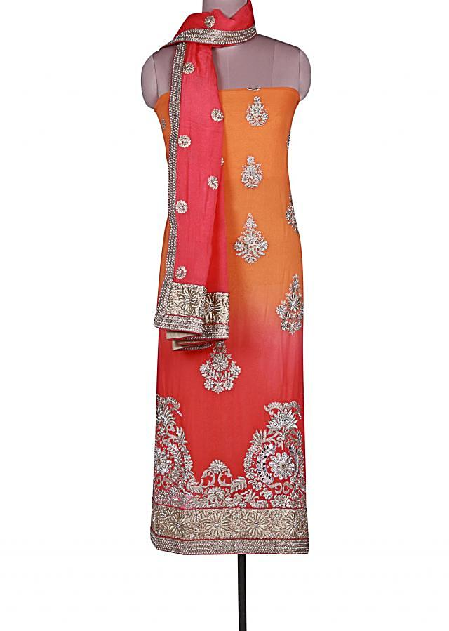 Shaded unstitched suit in peach and orange adorn in zari and mirror embroidery only on Kalki