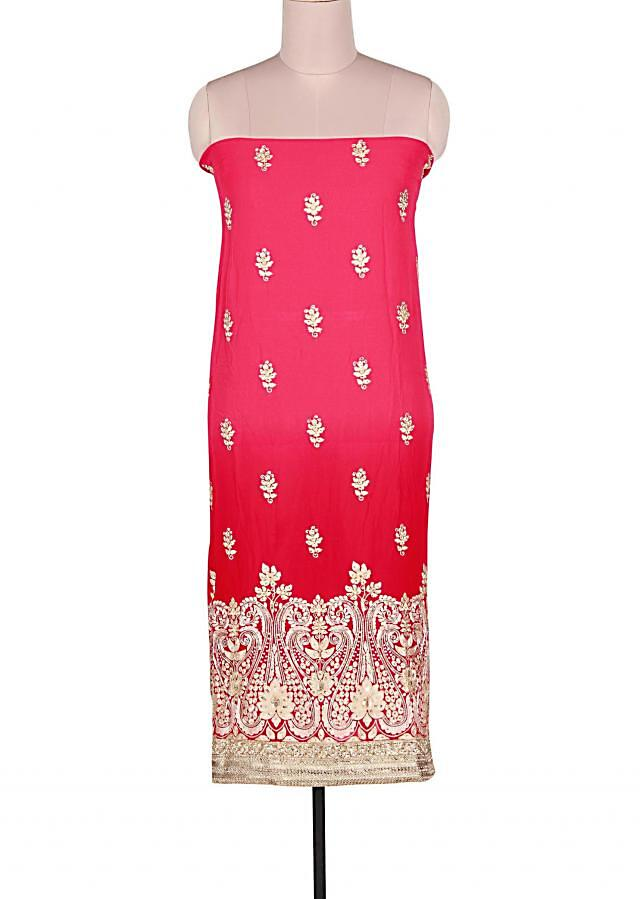 Shaded unstitched suit in pink and red adorn in resham and kardana embroidery only on Kalki