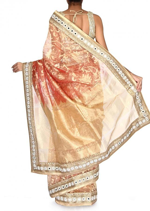 Poppy red and gold shaded saree adorn in embroidered border only on Kalki