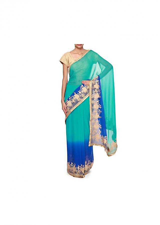 Shaded saree in turq and royal blue adorn in thread and kardana embroidery only on Kalki