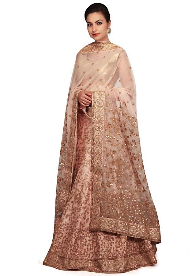 Shell pink lehenga with sequin jaal embroidery all over only on Kalki