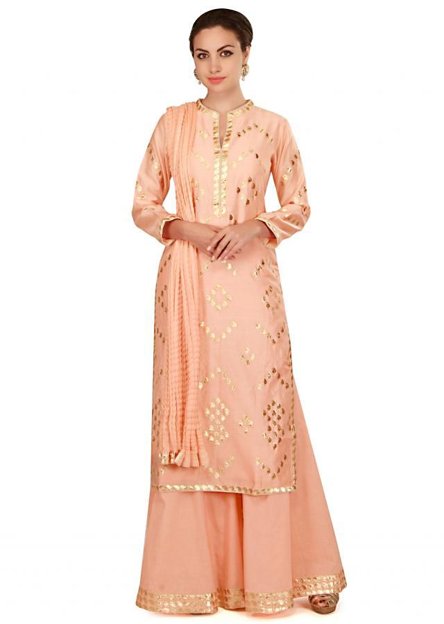 Shell pink straight suit in paisley motif all over only on Kalki