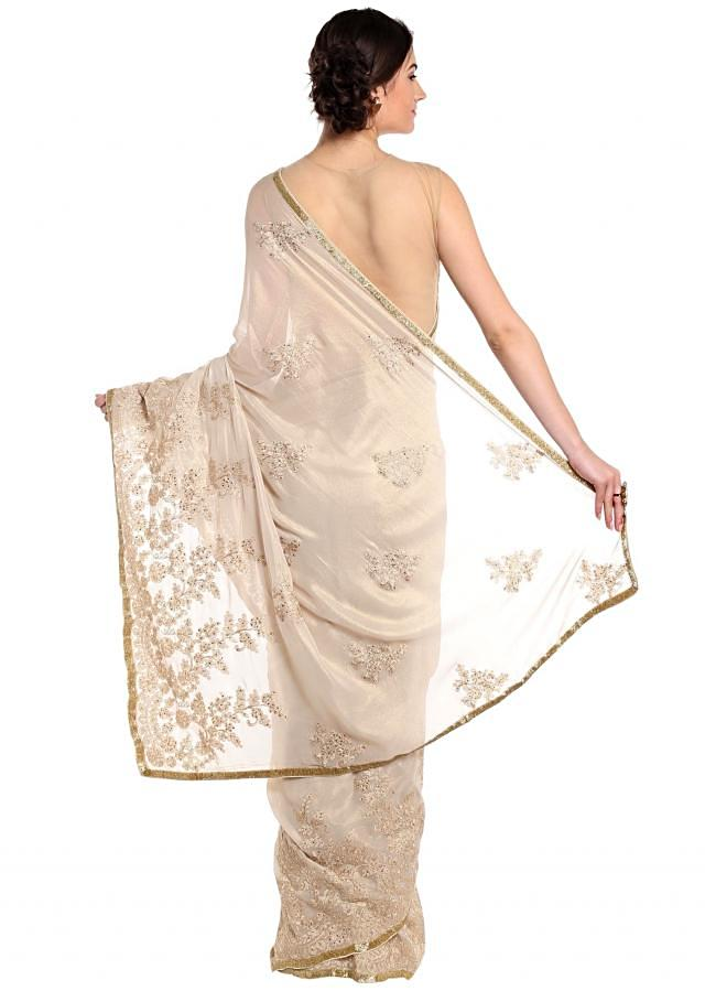 Shimmer gold saree adorn in kundan and thread work only on Kalki
